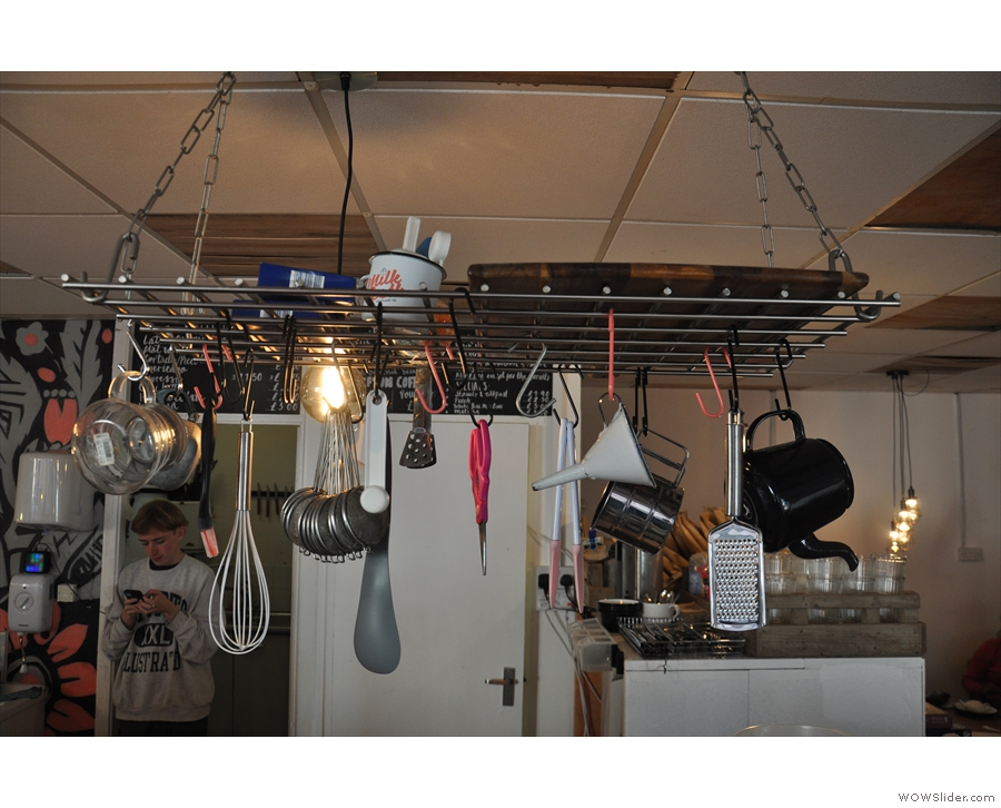 Talking of food, an interesting array of kitchen utensils hangs above the counter...