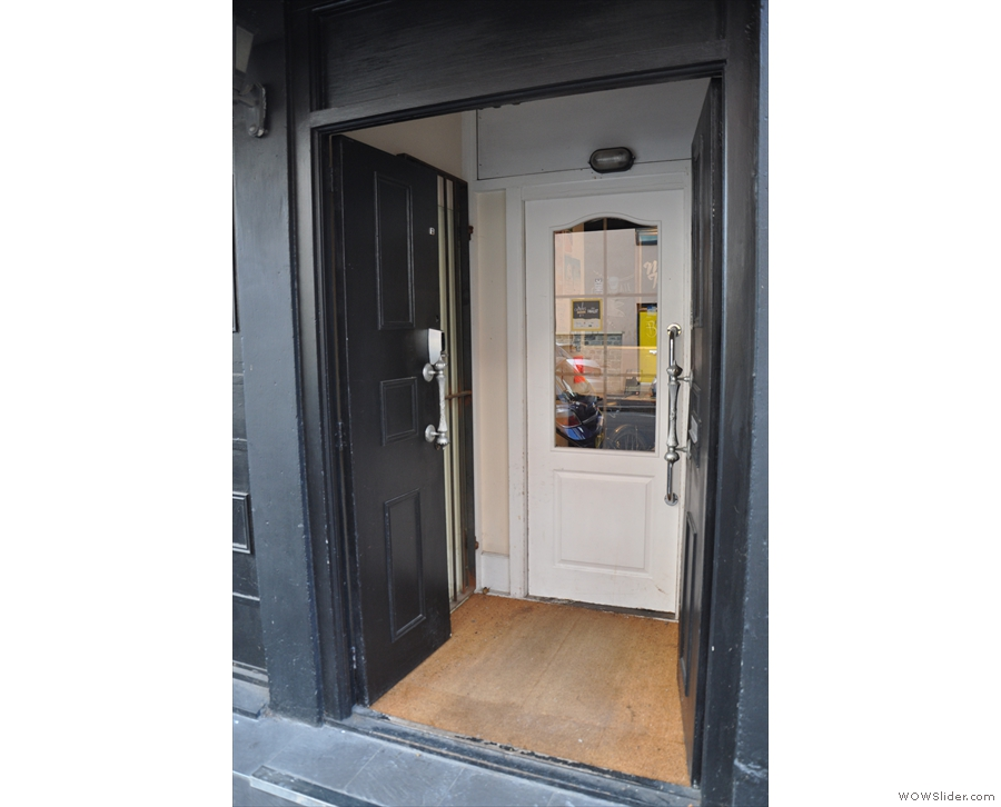 The door is at the far left-hand end, opening into a small, internal porch...