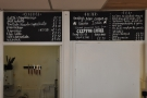... while on the wall above the door to the kitchen, there's the drinks menu.