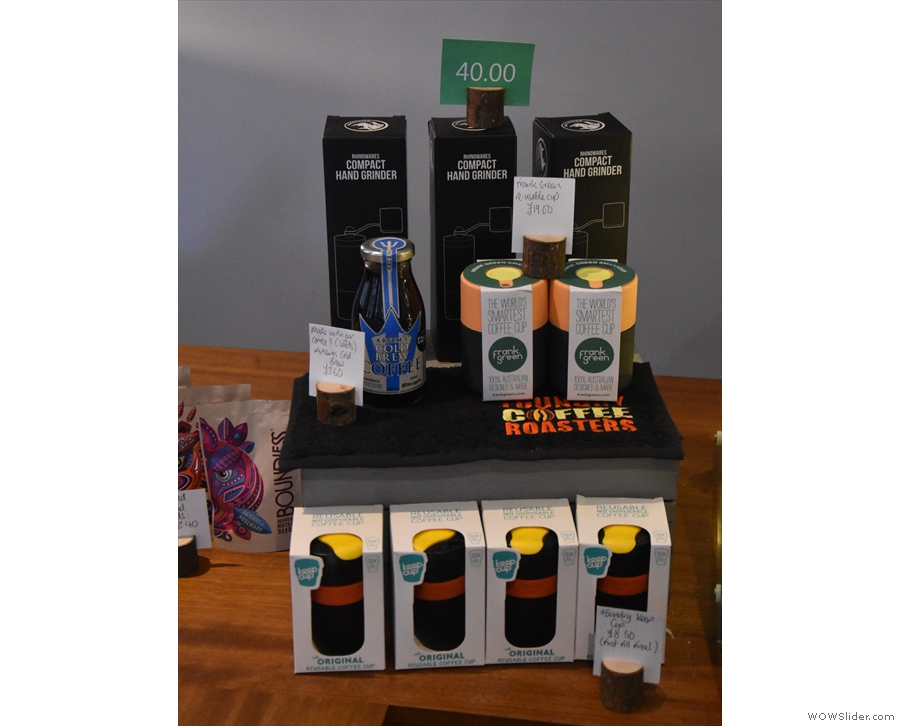You can also buy reuseable cups and grinders, which are neatly stacked on the counter.