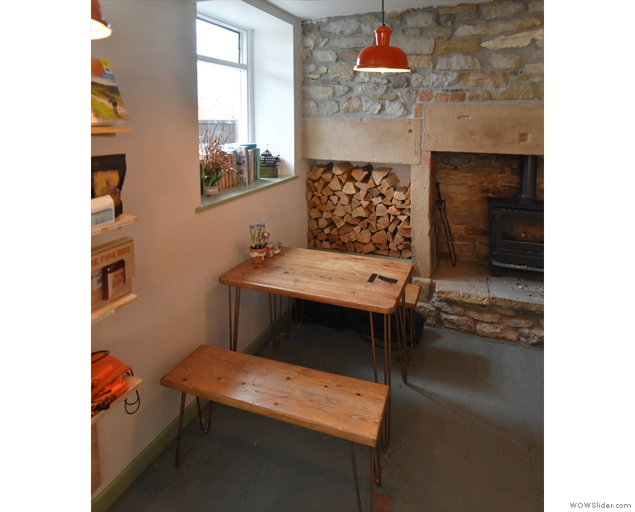 ... with another four-person table under the window in the back wall.
