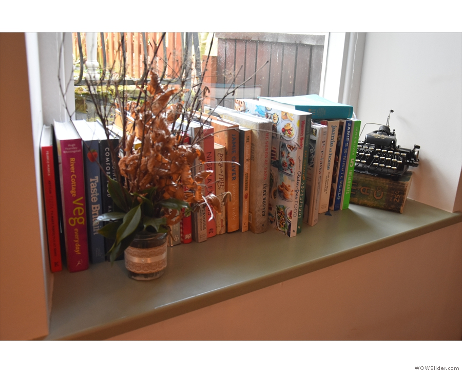 ... while in the back room, the window sill doubles as a cook book shelf. Nice typewriter.