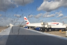 On the stand at Terminal 3, next to an Airbus A380.
