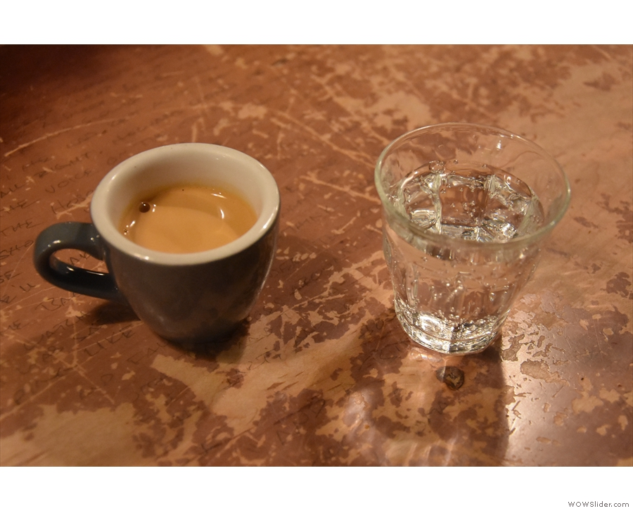 My espresso, served with a glass of sparkling water, of course.