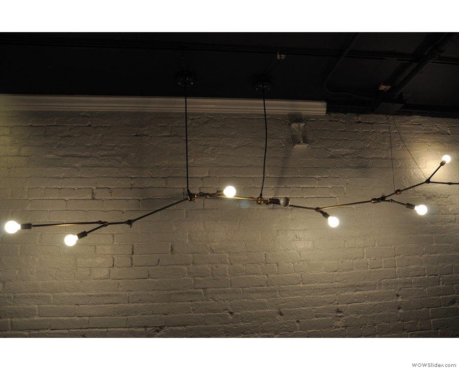 I was particularly taken by these light bulbs in a row along the wall above the bar.