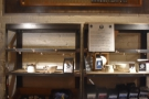 ... while on the opposite wall, there's another menu above the retail shelves.