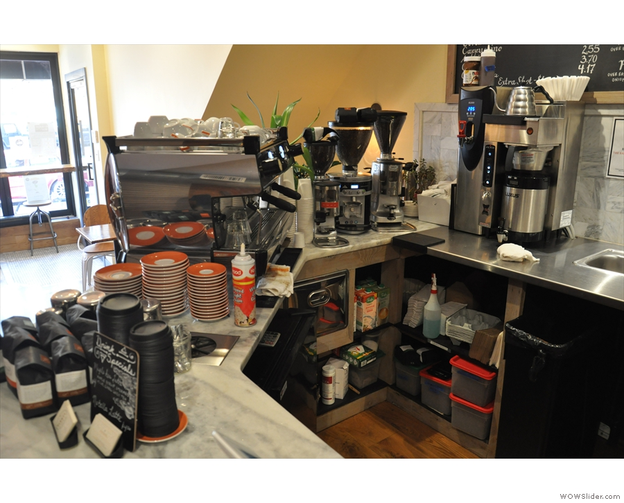The coffee set-up as seen from the till. The three grinders are house, single-origin & decaf.