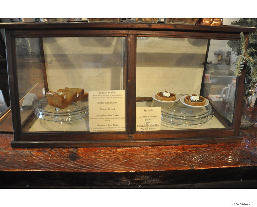 This lovely wooden case holds the baked goods, seen here in 2016...