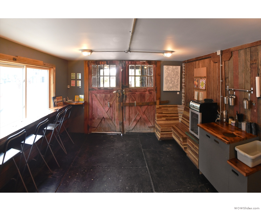 The doors open onto a long, low space with more than a little of the basement about it.