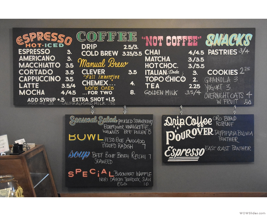 The menu is on a series of boards to the right of the counter.