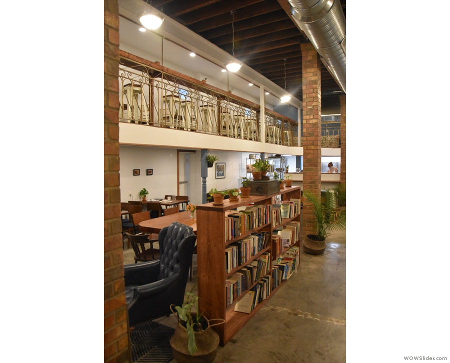 ... while the seating is off to the left, separated by these brick pillars & a bookcase.