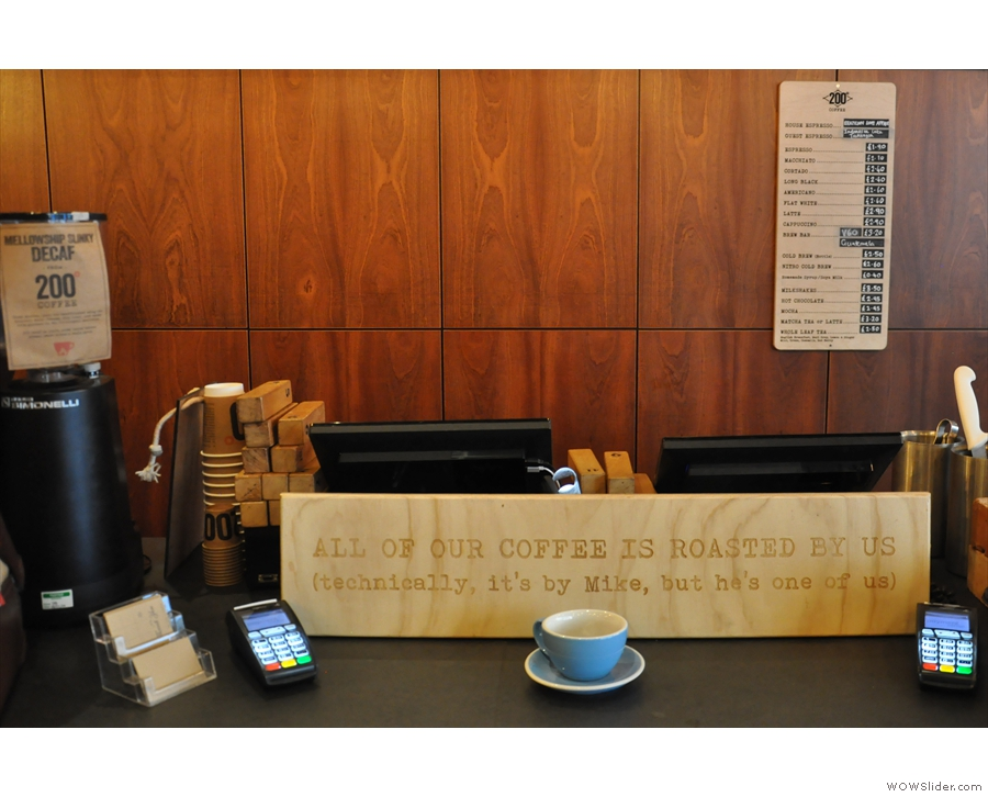 Finally, there's the till, between the coffee and cake, with the menu on the back wall.