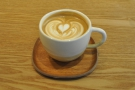... a creamy cappuccino, in fact, beautifully presented on a small wooden tray.