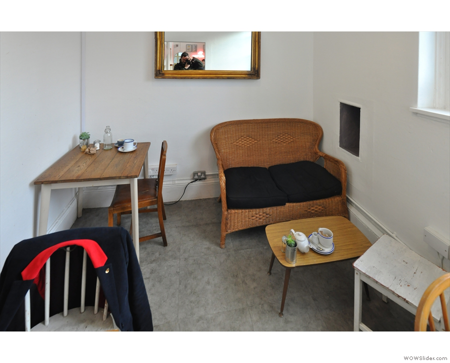 Then at the back, there's another small table in the corner against the far wall...