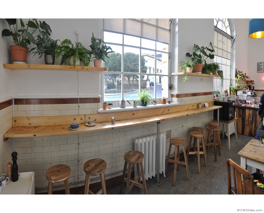 A panoramic view of the bar, seen from the other end.