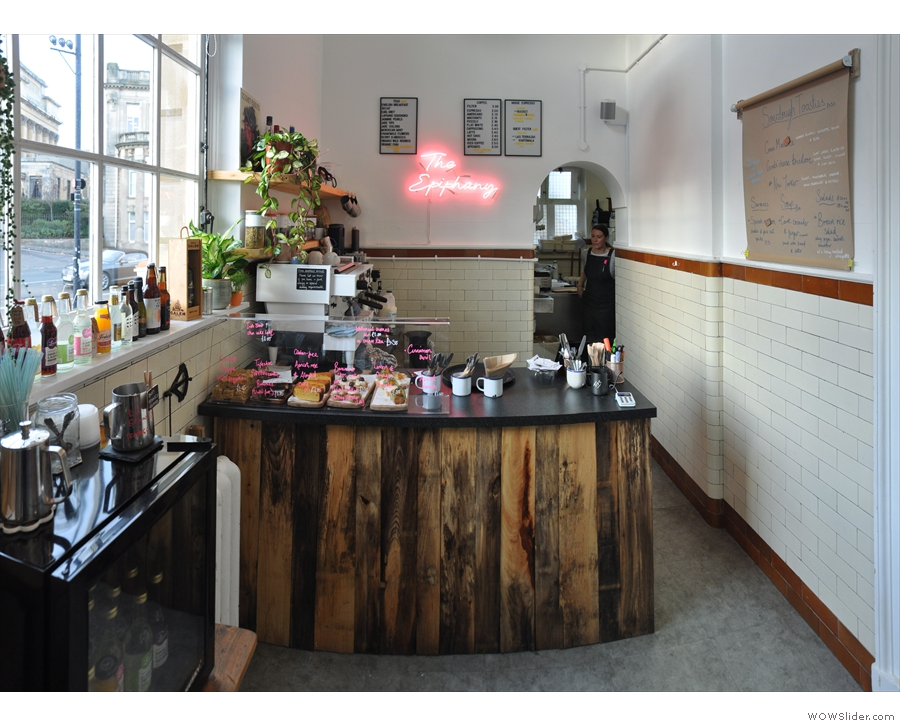 To business. The lovely, wooden counter is to your right as you enter, kitchen behind.