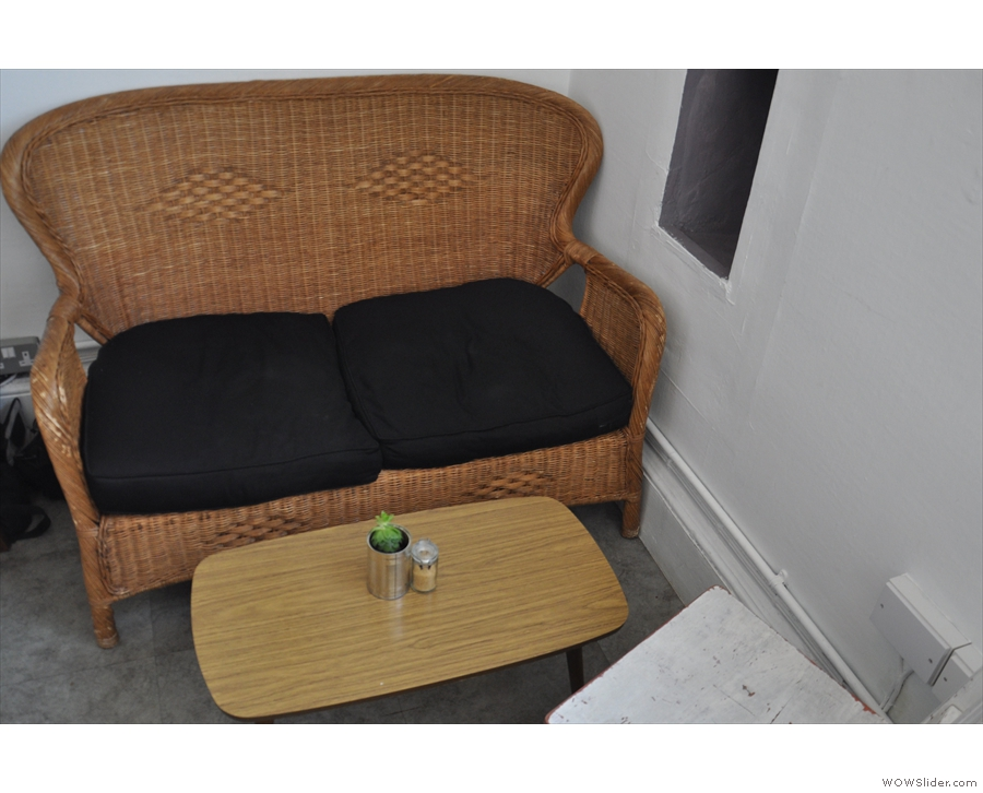 ... as well as this two-seater sofa and its coffee table. That's it for the seating in here...