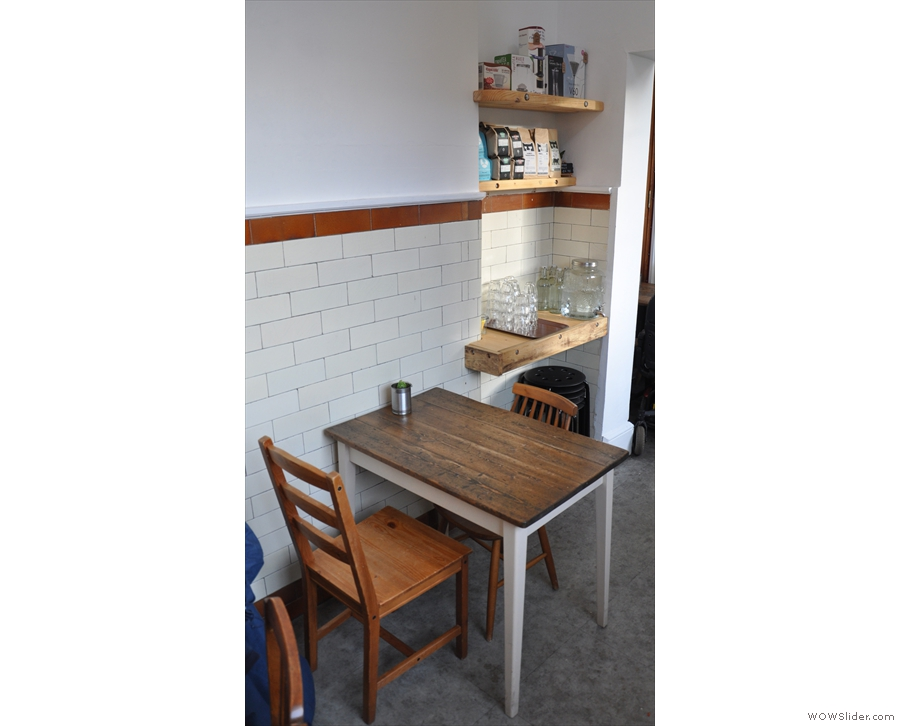 ... while there's a two-person table beyond that. Then comes a doorway...
