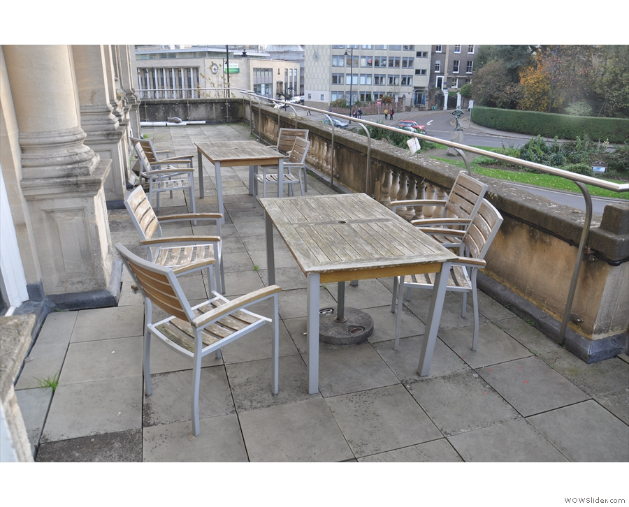... or head out onto the balcony, where you'll find tables to the left of you...