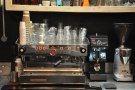 The espresso machine, a La Marzocco Linea, is at the back of the counter.