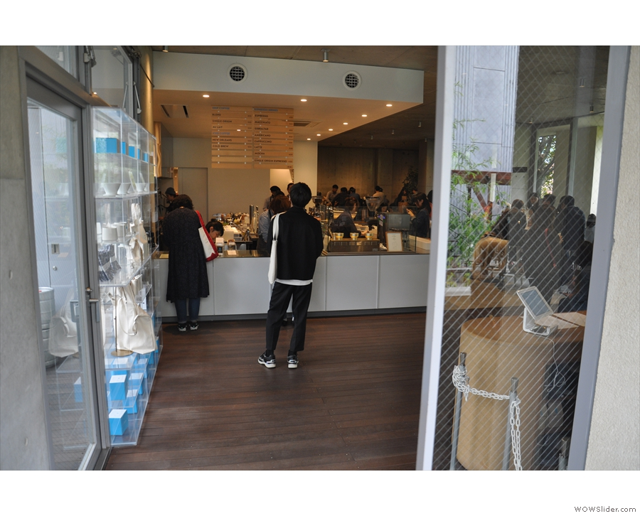 At the top, there's a shletered balcony to your right, the door opening into Blue Bottle.