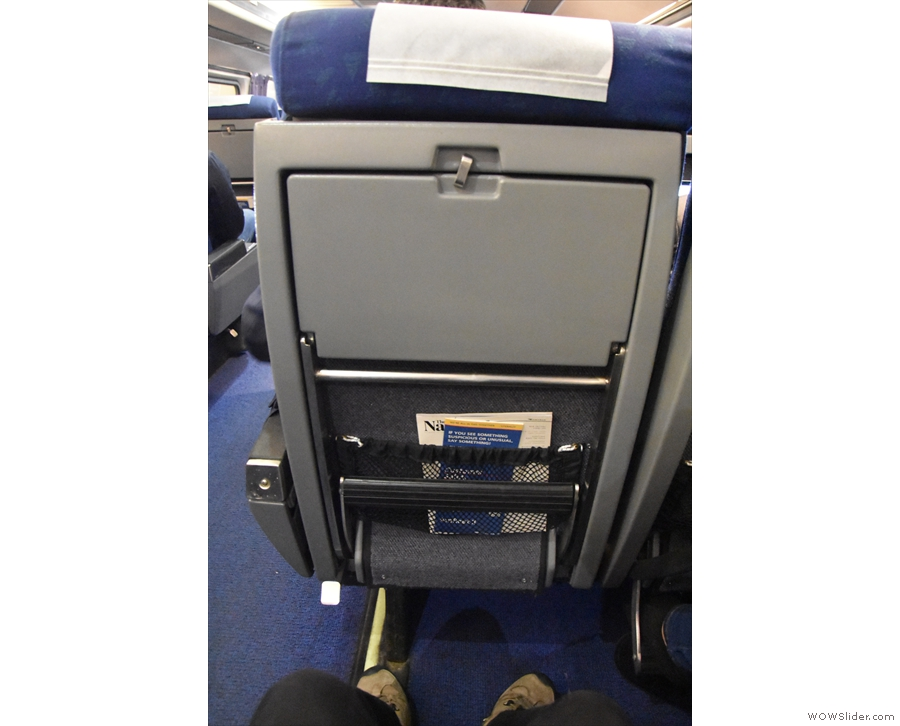 I snuck a look in business class. This is a standard coach class seat. So much leg room!