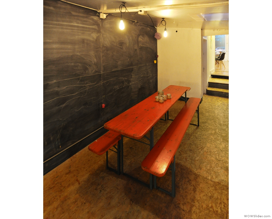 There's a large, communal table with benches on the right-hand side...