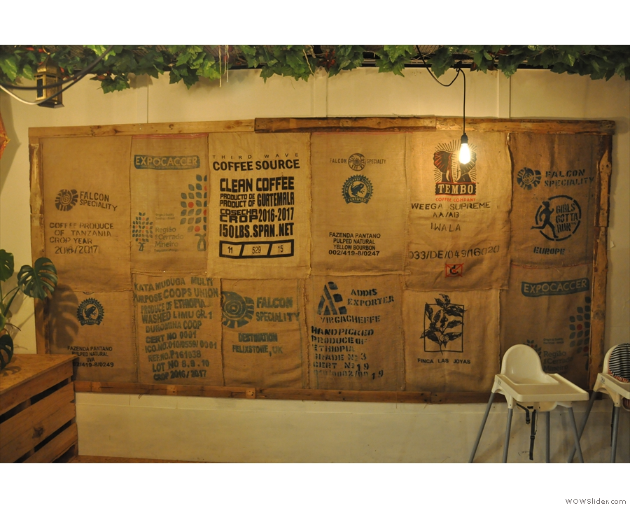 Meanwhile, old coffee sacks are used to decorate the walls.