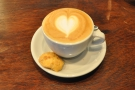 And the end result, my cappuccino, served with a little biscuit on the side.