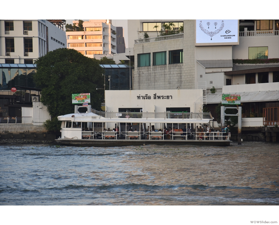 A public ferry runs between there and the Hilton. There are two boats, the white one...