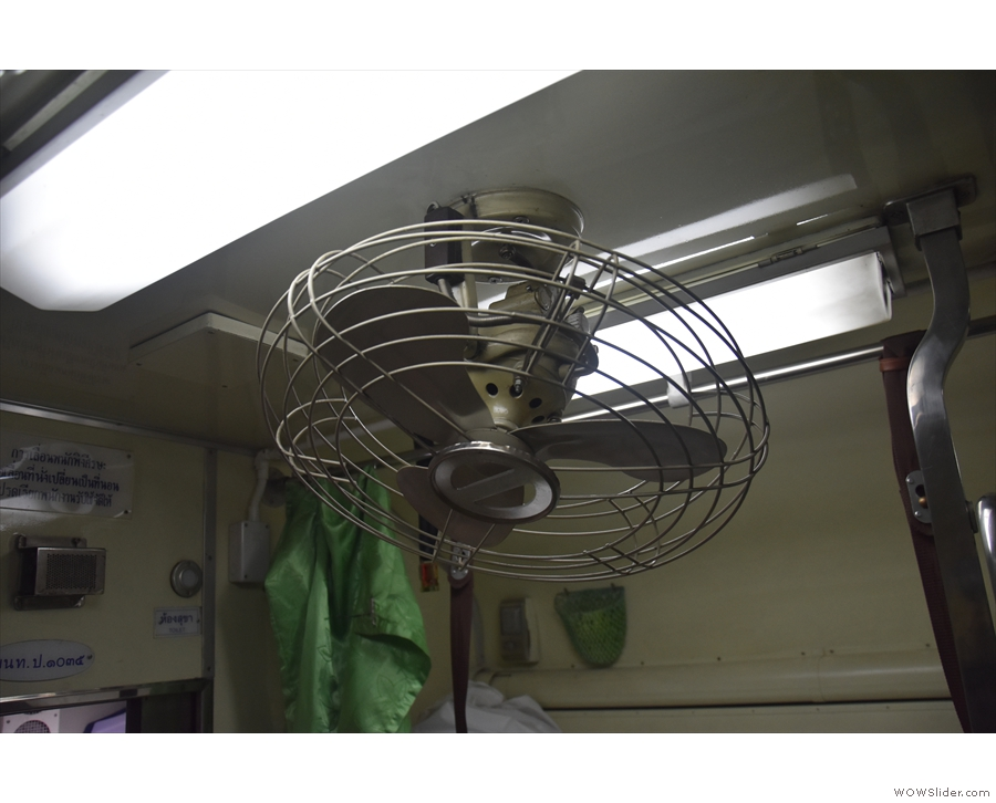 Although the carriage is air-conditioned, fans hang from the ceiling at regular intervals.