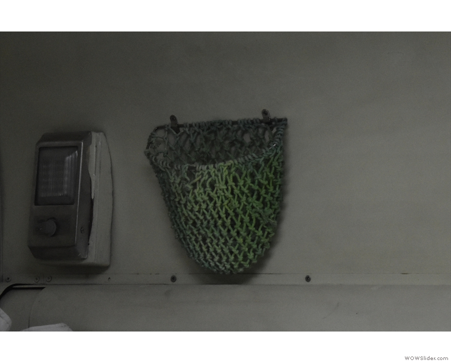 ... while there's an individual reading light and handy mesh basket for keeping small items.