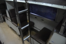 The ends of the luggage racks serve as ladders to allow access to the bunks.