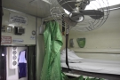 A green curtain can be drawn across each bunk for privacy...