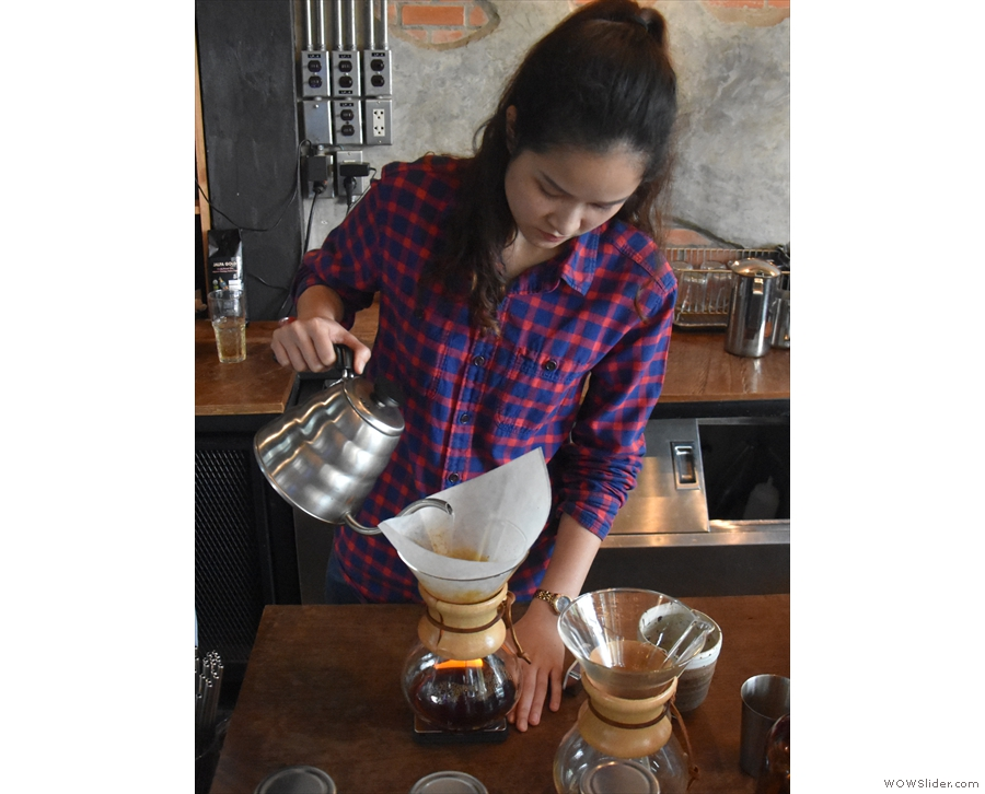 The short pours continue, the barista with a look of intense concentration on her face.
