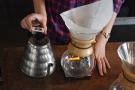 The kettle, which has been heating on an induction plate, has a quick temperature check...