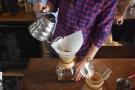 Once the coffee has bloomed, there's a series of short, controlled pours...