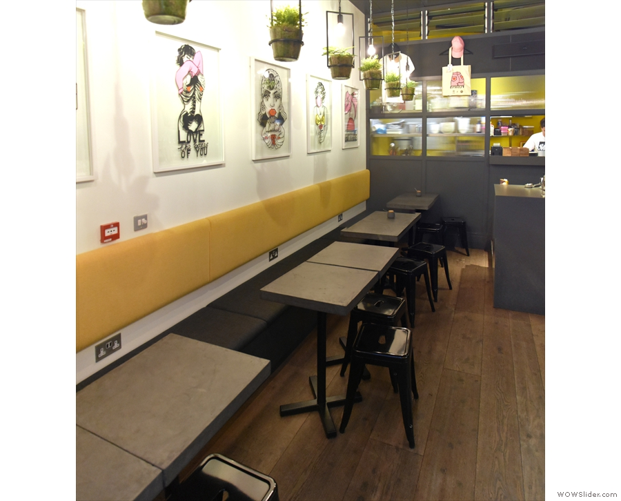 The kitchen is at the back, with the bulk of the seating down the left-hand side...