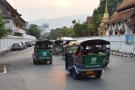 Tuk-tuks en masse, with the mountains of Chiang Mai vaguely visible in the distance.