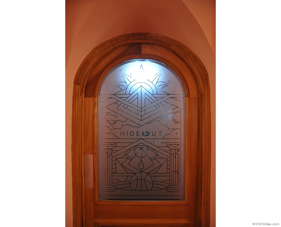 They open into a little foyer, where, at the back, is this interesting door...