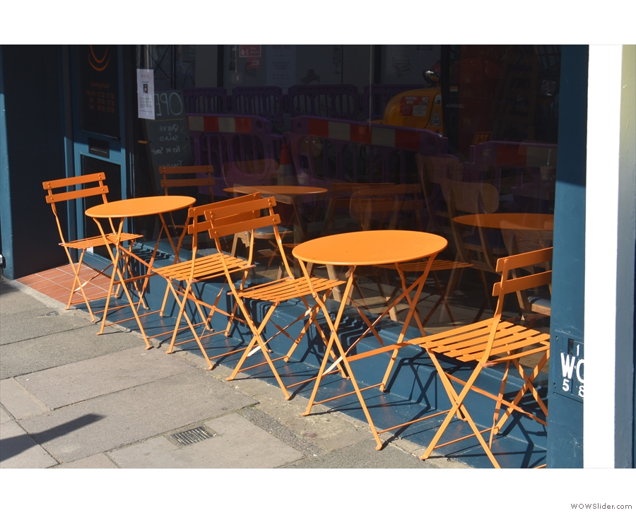 The small outside seating area catches the afternoon sun.