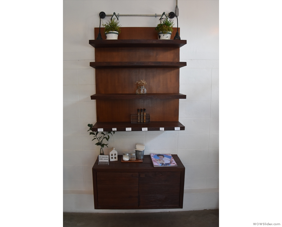Meanwhile, this dresser and shelves at the front act as a retail section.