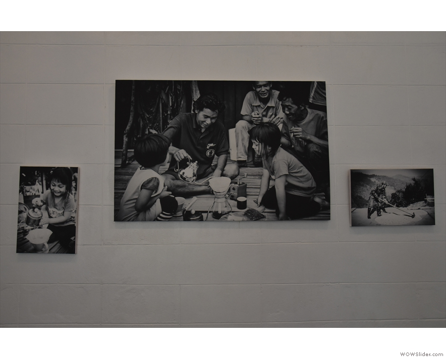 The plain white walls are sparsely decorated: these are pictures of a local coffee farm.