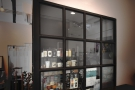 Beyond the counter is a glass-walled room...