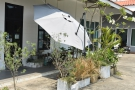 What looked to me like satellite dishes out front are, in fact, vast umbrellas, essential...