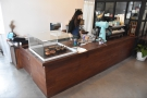 The counter is pretty much the first thing you encounter, the till off to the left at the front.