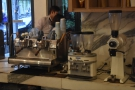 The two-group Synesso and its twin grinders (house + decaf) are at the back.