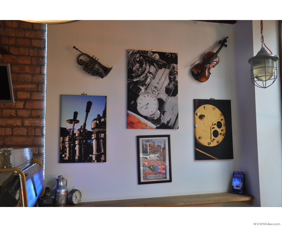 The decor is quirky... A trumpet and violin share space with pictures on the wall...
