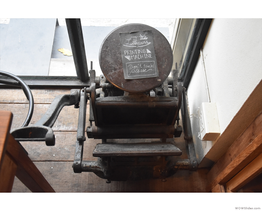 This lovely old printing press sits on the floor in the corner.