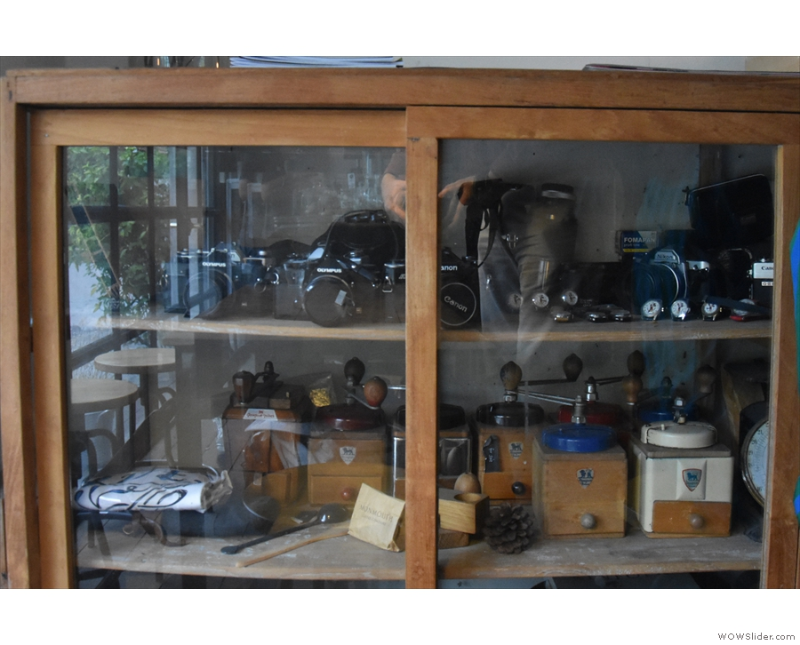 At the far end, a display case holds some vintage cameras, one of the owner's passions.